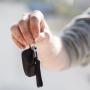 Person holding car keys